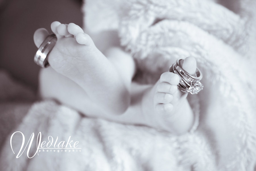 newborn toes with wedding rings