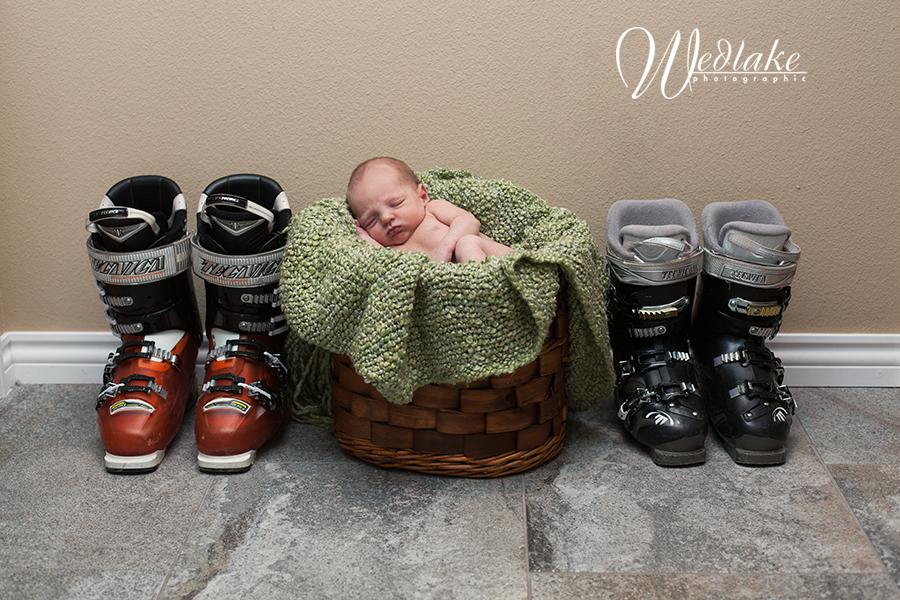 newborn baby with ski boots